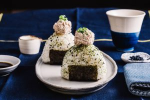 2 plated onigiri riceballs stopped with tuna salad