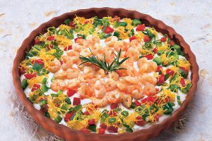 A large round dish of shrimp garden dip