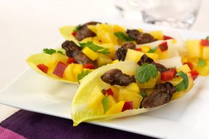 3 endive leaves filled with Smoked Oysters and Pineapple-Mango Salsa