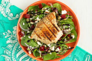 Grilled Black Pepper Yellowfin Tuna Steak on a bed of spinach and beet salad, feta cheese and smooth balsamic glaze.