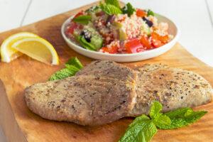 2 Black Pepper Yellowfin Tuna Steaks with Mediterranean couscous salad