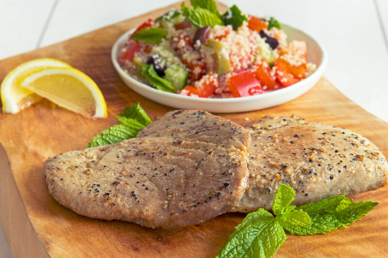 2 Black Pepper Yellowfin Tuna Steaks with Mediterranean couscous salad