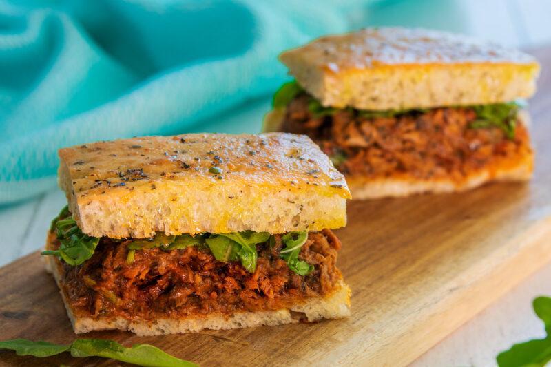 2 Savoury High Protein Italian Tuna Focaccias on a wooden board