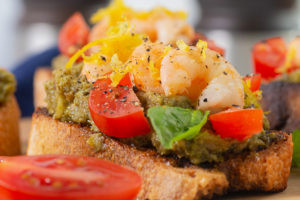 Close up of a piece of Walnut Pesto & Garlic Shrimp Bruschetta