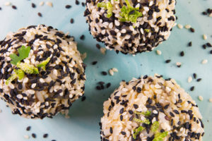 A top view of 3 sesame crusted Smoked Oyster Rice Balls