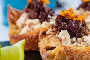 Close up of 2 Crispy Wonton Cups With Orange Tuna And Spicy Olive Tapenade