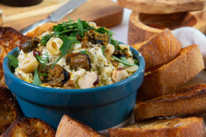 A ramekin of Ocean's Smoked Mussels, Hazelnut And Ricotta Crostini