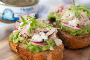 Tuna Avocado Toast with thinly sliced radish and feta crumbles