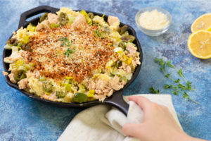 Modern Low Carb Tuna Casserole in a skillet with lemon on the side